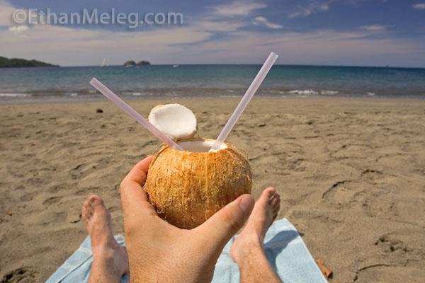Ethan Meleg Drinking Coconut Milk On Pacific Beach In Costa Rica Photo